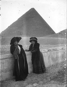 Well-dressed (vintage) tourists at the Giza Pyramids, Egypt. Late nineteenth century.  Victorian, Women, Dress.