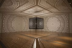 Intersections art installation by Anila Quayyum Agha uses laser-cut wood and a single light bulb to create giant architectural shadows, wins 2014 ArtPrize.