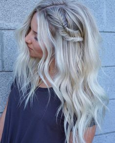 Fishtail braid leading into loose, tousled beach waves on this stunning bright blonde.