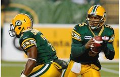 Edmonton Eskimos quarterback Kerry Joseph rolls out for a pass during CFL action against the Hamilton Tiger-Cats at Commonwealth Stadium on Oct. 5, 2012.