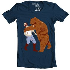 Bear Strikes Back Men's Tee. 7 years after the Haymaker, the bear makes a comeback just as epic as the original. See the other side to the punch with this design: The Bear Strikes Back. Printed on a high-quality 100% cotton navy men's tee, The Bear Strikes Back is guaranteed to keep your Sharp Shirter collection fresh.