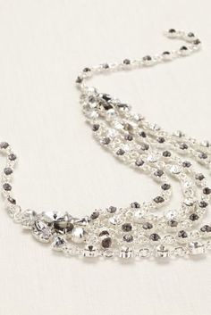 Truly Zac Posen tiered crystal and silver chain necklace.  Style ZP704514 at David's Bridal.