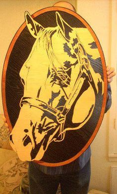 Gorgeous portrait of a horse inside an oval.  Made of wood and done on a scroll saw
