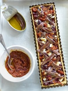 Enjoy this tomato tart recipe from Jamie Oliver which has black olives, feta and anchovy added to the filling, adding some serious punch to the flavour. Salmon Fishcake Recipes, Anchovy Recipes, Tart Recipes, Fish Recipes, Vegetable Recipes, Salad Recipes, Vegetarian Recipes, Cooking Recipes, Healthy Recipes
