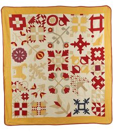 Sampler quilt, 1914, with a mixture of pieced and appliqued blocks. Embroidered with dog and cat names. collection of Shelly Zegart