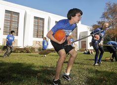 Aaron Solomon and other members of the Eleanor Roosevelt High School quidditch team practice in Greenbelt.