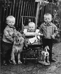 Three solemn children and their dog