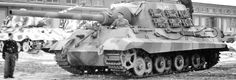 A rather new condition Jagdtiger at a German refurbishing center..note the King Tiger with Porsche turret in the rear