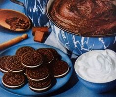 Brownies in a dutch oven: layer pf cookie dough, layer of oreos, layer of brownie mix. Wow, lets go camping!