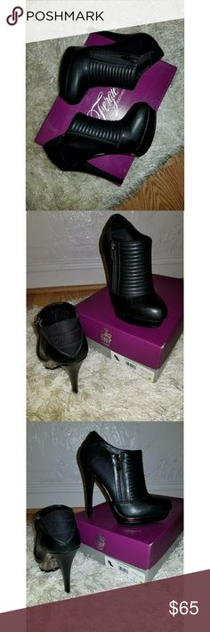 """Fergie """"Wander"""" Black Leather Zip-Up Ankle Booties Fergie Footwear """"Wander"""" black leather zip-up heeled ankle booties with gunmetal detail on platform and zipper. Quilted moto design on top of foot. Size 7 / Euro 37. Only tried on inside. Never been worn. Fergie Shoes Heeled Boots"""