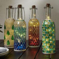 Best DIY Ideas and Designs of Wine Bottle Craft - Live Enhanced bottle crafts lights Wine Bottle Craft Ideas Old Liquor Bottles, Liquor Bottle Crafts, Wine Bottle Art, Painted Wine Bottles, Lighted Wine Bottles, Diy Bottle, Bottle Lights, Wine Bottle Lanterns, Beer Bottle