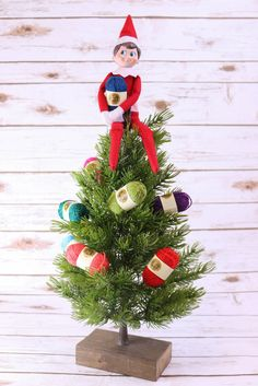 Percy the Prime Elf is decorating the tree with @lionbrandyarn  bonbons! #PrimeElf #ElfOnTheShelf  What's your elf up to?