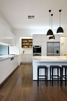 white kitchen with bell shape shade in matte black made of carbon steel. White kitchens are able to transform a home. If you want a cozy vintage or scandinavian kitchen, you need to use white in your modern kitchen ideas. See more home design ideas at htt Best Kitchen Designs, Modern Kitchen Design, Modern Design, Modern Kitchen Lighting, Galley Kitchen Design, Kitchen Industrial, Industrial Style, Kitchen Interior, New Kitchen