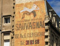 A hand painted Ghost Sign from Beziers in the south of France - it reads 'Mister Furniture Sauvagnac' Photograph: Sam Roberts/ http://www.ghostsigns.co.uk