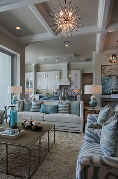 creating a coastal style interior using a color palette of blues aquas and natural browns accented by metallic silvers and greys -
