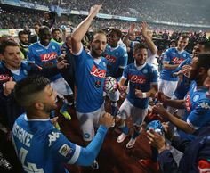 Players of Napoli celebrate after the Serie A match between SSC Napoli and Frosinone Calcio at Stadio San Paolo on May 14, 2016 in Naples, Italy.