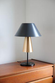 Beacon. table lamp. cast iron base. spun aluminium shades. brass. grey.  http://www.magnuspettersen.com