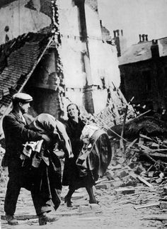 """18 1941 The Swansea Blitz. Another official image of people stoically getting on with it after being made homeless. - See more at: http://ww2today.com I knew his wife should have been with him and I called up to him to ask where she was. He pointed down to the rubble and said """"down there, under that lot"""". We started to pull away the bricks and shattered wood with our bare hand and soon the rescue unit came and we then stood back for them to dig. After about an hour we found her under a very…"""