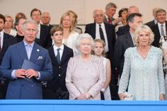 The Queen attending the Coronation festival with Charles and Camilla