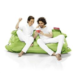 Buggle-Up Bean Bag - Lime Green: Combining comfort with an outdoor lifestyle, the Buggle-up is the ideal complement to your garden or terrace.  Its tough fabric can withstand UV rays, water and dirt and its ingenious design means it is both a perfect leisure chair for one or an intimate snuggle sofa for two – you can switch effortlessly between the two.  The Buggle-up is available in 16 colours, ranging from Yellow Ochre and Pink for a quirky contemporary look to Taupe and Black for timeless…