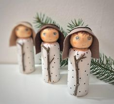 Nativity / Adoration / Epiphany wooden peg doll set Figurines ( wooden peg dolls ) measure 3 1/2 inches ( 9 cm ) All decorative items are handmade, painted with nontoxic acrylic paint and firmly attached to the dolls ( Magis gifts, crowns, halos etc). Not recommended for children under 3