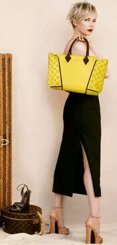 Michelle Williams for Louis Vuitton, #Fall 2013 #louisvuitton   See more about yellow bags, michelle williams and louis vuitton.