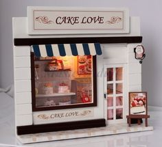 "1:12 Dollhouse Miniature 7"" Height Deluxe CAKE SHOP DIY with Furniture, Accessories & Lighting  The size is in proportional to a real one. The decoration and furniture, not just simulate to real scenarios, the materials used are also similar to real one. For example, the cabinet is made of wood, the window is made of soft cloth, and the book is made of paper."