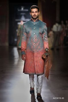 Green- Red silk sherwani featuring a Jamawar shawl print paired with a silk kurta-churidar