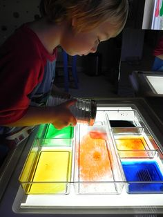 """""""Volcano water"""" the excellent blog, Play at Home Mom. Combine vinegar and food coloring and add baking soda with a shaker you get from the dollar store  --- they did it on a light box, but it's not necessary.  Make sure they put their hands in it when the soda is reacting with the vinegar!"""