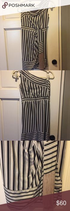 """BCBG Max Azria One-Shoulder Striped Dress, XS Classy and fun BCBG Max Azria one-shoulder navy/cream striped dress. Size XS but it has been taken in on the top to fit me. I'm a size 32B so if you're around that or smaller it will be a perfect fit. If not you could always get it taken out. That belt with tassels is sewn in and not removable. Length hits close to the knees so not too short (I'm 5'11"""" in that picture with heels!). Worn once to Kentucky Derby party as pictured. Perfect for…"""