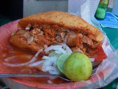 #TortasAhogadas en #Guadalajara, #Jalisco... @Candidman    Es un platillo que sólo se puede comer en la ciudad de Guadalajara debido a que el #Birote salado no se elabora en otro sitio.     Se rellena de #Carnitas y se baña en una salsa picante.