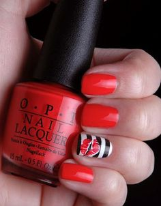 orange-red nails with stripes and lips nail art