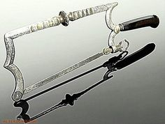"""Backward """"Scissors (1500) central probe is inserted into the wound, after which the wound was extended for the convenience of the surgeon"""