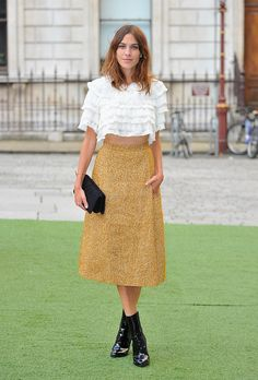Surprise! Alexa Chung Is Launching her own FashionLine | Browse 20 street style looks that epitomize Chung's quirky-cool, boy-meets-girl style | @stylecaster | ladylike ruffle top + a-line midi skirt
