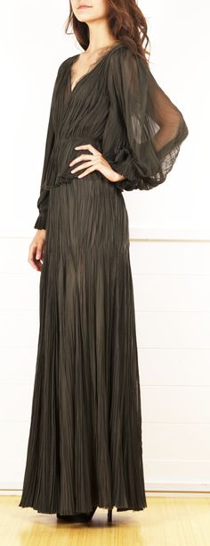 A raw silk scalloped long sleeve gown featuring a low back v and slightly sheer, exaggerated sleeves