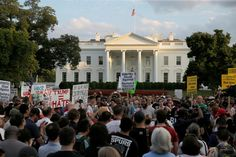 """People gather for a vigil in response to the death of a counter-demonstrator at the """"Unite the Right"""" rally in Charlottesville outside the White House on August 13, 2017."""