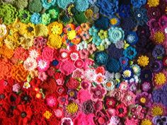photo of many crochet flowers - made for yarndale and then for Sheilas charity project for the Alzheimers Society