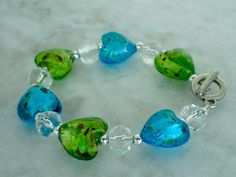A personal favorite from my Etsy shop https://www.etsy.com/listing/454598104/6-34-murano-glass-heart-bracelet