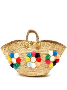Click here to buy Muzungu Sisters Sicilian pompom straw tote at MATCHESFASHION.COM