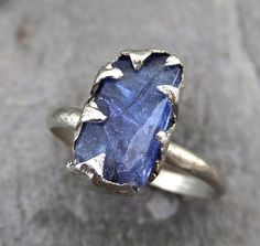 Hey, I found this really awesome Etsy listing at https://www.etsy.com/listing/245425808/raw-tanzanite-crystal-white-gold-ring