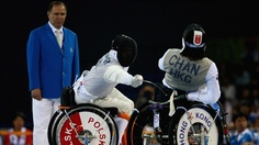 Wing Kin Chan of Hong Kong China fences with Dariusz Pender of Poland in the Individual Foil Category A bronze medal match in the Wheelchair Fencing Competition. #Olympics Olympics