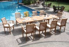 "New 11 Pc Luxurious Grade-A Teak Dining Set - Large 117"" Rectangle Table And 10 Stacking Arm Chairs [Model:MS7] by WholesaleTeak. $1759.99. You can lengthen the table with minimal effort by simply opening the butterfly leaf extensions.. Chair Dimension: 24 1/2"" Width x 19"" Depth x 37 1/2"" Height. Rectangle Table Dimension:82"" L (without extension) and 117"" L (with extension), 42.5"" W , 29.5"" H. ADD SUNBRELLA FABRIC CUSHIONS BY SEARCHING ""Wholesaleteak Dining Cushion""..."