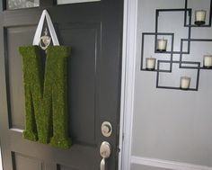 moss monogram for the front door, a little change from a wreath.
