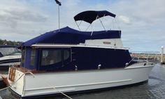 lovely timber boat with covers in Sunbrella by Canvas Barn Marine Trimming. Bimini, Flybridge cover, Windscreen covers