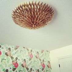How FAB is this gold olive leaf chandelier from Shades of Light! #nursery