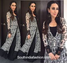 For her appearance at a recent do, Karisma Kapoor picked a long, layered, black & white gown by Anita Dongre. She looked charming as ever in a cute hair do Kurta Designs, Blouse Designs, Dress Designs, Indian Attire, Indian Wear, Pakistani Outfits, Indian Outfits, Peach Gown, India Fashion