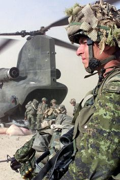 100 Images From Afghanistan - Day 31. A Canadian soldier from Charlie Company, attached to the Third Battalion Princess Patricia's Canadian Light infantry provides perimeter security around a Chinook helicopter before heading back to Kandahar, Afghanistan. The soldiers were deployed on a mission approximately 100 km North-west of Kandahar Airfield in order to deny use of a large cave and to destroy ammunition and weapons that were turned over to coalition forces by local authorities in the…