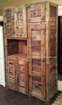 7' x 4' cabinet made from 9 4' x 3' pallets (along with a few tree stakes for support, and plywood for the shelves and back).