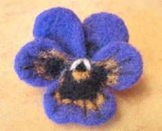 Needle felting a pansy - good beginners project with lots of illustrations.