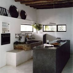 rustic + modern... a little on the modern side, but i dig the stone sink